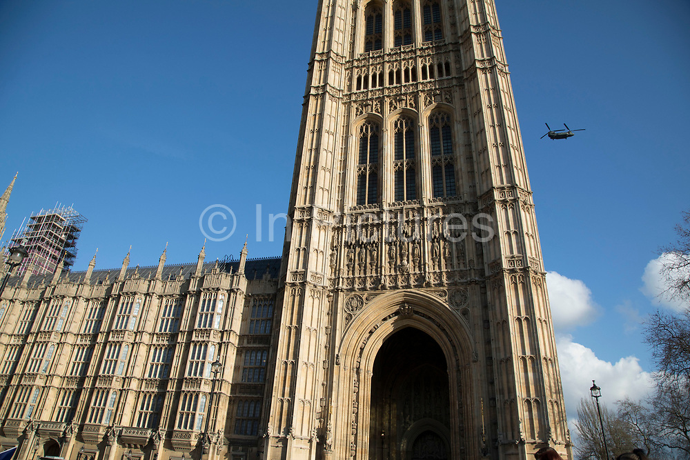 Chinook helicopters fly over the Houses of Parliament in London, England, United Kingdom. Part of a network of routes, known as the heli-lanes through London where helicopters can fly visually without needing to satisfy the equipment requirements of Class A Airspace.