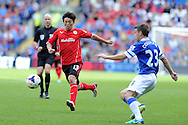 Kim Bo-Kyung of Cardiff city in action. Barclays Premier league, Cardiff city v Everton at the Cardiff city Stadium in Cardiff,  South Wales on Saturday 31st August 2013. pic by Andrew Orchard,  Andrew Orchard sports photography,