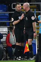 Football - 2018 / 2019 Premier League - Cardiff City vs. Huddersfield Town<br /> <br /> shows the red card to consults his linesman after awarding a penalty against cardiff, at the Cardiff City Stadium.<br /> <br /> COLORSPORT/WINSTON BYNORTH