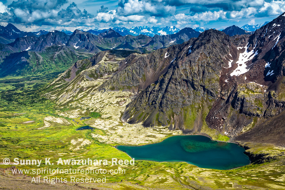 Overlook of Avalanche Mountain and Ship Lake under blue sky, Chugach State Park, Southcentral Alaska, Summer.