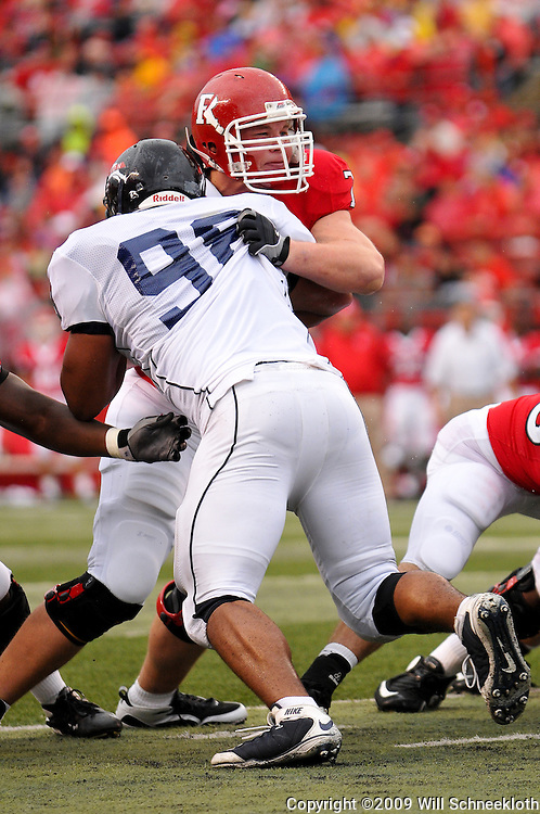 Sep 12, 2009; Piscataway, NJ, USA; Rutgers offensive lineman Mo Lange (76) blocks Howard defensive tackle Will Croner (98) on an extra point attempt during the first half of Rutgers' 45-7 victory over Howard in NCAA College Football at Rutgers Stadium.