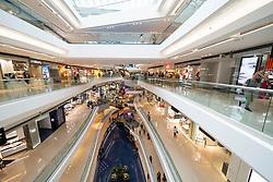 Interior of modern Festival Walk shopping mall in Kowloon Tong , Hong Kong.