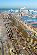 Nederland, Zuid-Holland, Rotterdam, 18-02-2015; Tweede Maasvlakte (MV2). Europaweg en Emplacement Maasvlakte West (Rail Terminal West). Aean het water van de Hartelhaven het Emplacement Maasvlakte Oost. In beheer bij Keyrail, exploitant Betuweroute. <br /> Zicht op de eleckrticiteitscentrales van E.ON.<br /> Emplacement Maasvlakte West (West Rail Terminal) and  next to the Hartelharbour  the Emplacement Maasvlakte East. Managed by Keyrail, operator Betuweroute.<br /> <br /> luchtfoto (toeslag op standard tarieven);<br /> aerial photo (additional fee required);<br /> copyright foto/photo Siebe Swart
