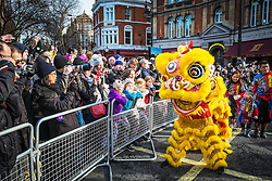 Chinese New Year 2016 - The Year of the Monkey.  In the biggest celebration outside of Asia, costumed performers took part in the Chinese New Year Parade along Charing Cross Road and Chinatown. London Feb 2016