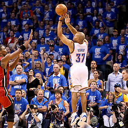 Jun 12, 2012; Oklahoma City, OK, USA;  Oklahoma City Thunder point guard Derek Fisher (37) shoots over Miami Heat power forward Chris Bosh (1) during the first quarter of game one in the 2012 NBA Finals at the Chesapeake Energy Arena.  Mandatory Credit: Derick E. Hingle-US PRESSWIRE