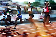Phylicia George, second from right, makes her way to a win in the 100-metre race at the Canadian Track and Field Championships in Calgary, Alta., Friday, June 29, 2012.THE CANADIAN PRESS/Sean Kilpatrick