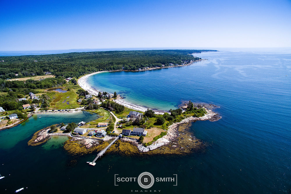 Fish Point in the foreground with Pemaquid Beach on a high tide, looking out to Johns Bay and the Gulf of Maine