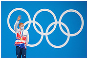 Tom Dean wins Gold for Team GB during the Men's 200m Freestyle medal ceremony at the Tokyo 2020 Olympic Games.