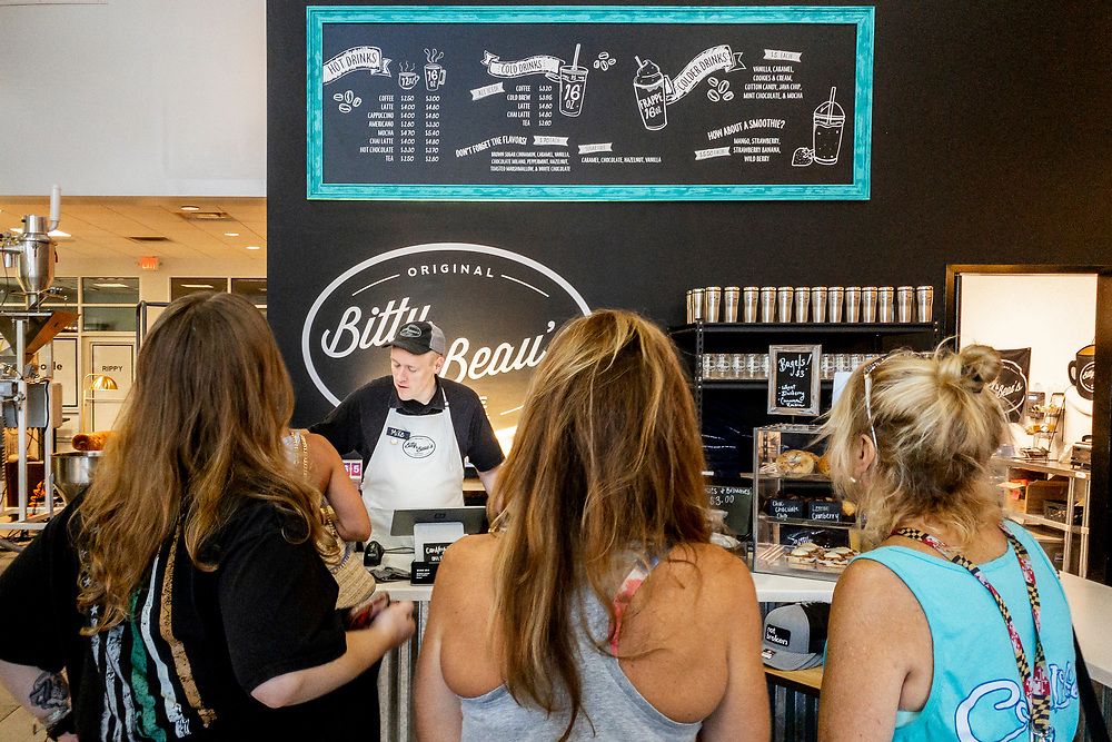 Waiting in line for a fresh coffee at Bitty & Beau's Coffee - the original location at Flow Cadillac of Wilmington - in Wilmington, North Carolina on Friday, August 13, 2021. Copyright 2021 Jason Barnette