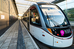 View of tram at platforms at modern Edinburgh Gateway railway and tram station that connects Scotrail train passengers with the Edinburgh Tram link  in Edinburgh, Scotland, United Kingdom.