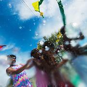 CRAIG HUDSON   Gazette-Mail.<br /> From left, Ana Collins, Ania Jones, Asan Jones and Joshua Gray cool off at the Magic Island splash pad in Charleston,W.V., on Wednesday, June 28, 2017.