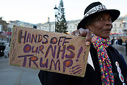 Protester Gloria at the No to Trump, No to NATO, Hands off our NHS Demonstration on 3rd December 2019 in London, United Kingdom. Donald Trump is visiting London or the NATO Heads of State summit on the 70th anniversary of the organisation, which the Queen will be hosting a reception for NATO leaders at Buckingham Palace. Meanwhile, there is fear that Boris Johnson and Donald Trump will be in discussion about opening up the NHS to US corporations. Organisers were Together Against Trump which is a collaboration between the Stop Trump Coalition and Stand Up To Trump.