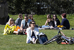 © Licensed to London News Pictures. 17/04/2021. London, UK. Members of the public relax and enjoy the sunny weather in Green Park in central London. Temperatures are expected to rise with highs of 16 degrees forecasted for parts of London and South East England later this week . Photo credit: George Cracknell Wright/LNP