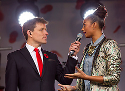 © Licensed to London News Pictures. 24/10/2012. LONDON, UK. TV presenter Ben Shephard is seen talking to singer and X-Factor judge Alesha Dixon at the launch of the Royal British Legion's 2012 Poppy Appeal in Trafalgar Square, London, today (24/10/12).  Photo credit: Matt Cetti-Roberts/LNP