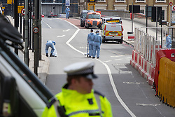 London, June 4th 2017. Police collect evidence on London Bridge during a massive policing operation in the aftermath of the terror attack on London Bridge and Borough Market on the night of June 3rd which left seven people dead and dozens injured