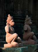 Statues at the entrance to Banteay Srei, a Hindu temple at Angkor, Siem Reap Province, Cambodia