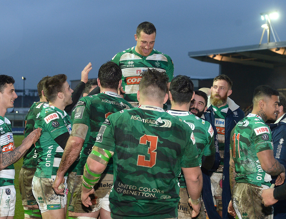 Benetton Rugby's Alberto Sgarbi celebrates completing his 200 competitive game and is hosted into the air by his team mates <br /> <br /> Photographer Ian Cook/CameraSport<br /> <br /> Guinness Pro14 Round 15 - Dragons v Benetton Rugby - Sunday 18th February 2018 - Rodney Parade - Newport<br /> <br /> World Copyright © 2018 CameraSport. All rights reserved. 43 Linden Ave. Countesthorpe. Leicester. England. LE8 5PG - Tel: +44 (0) 116 277 4147 - admin@camerasport.com - www.camerasport.com