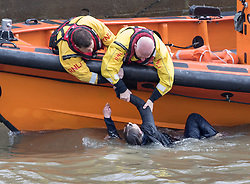 © Licensed to London News Pictures. 29/03/2017. London, UK. An RNLI crew pull a person from the River Thames under Westminster Bridge. This is the second person who has jumped in to the River from Westminster bridge in the space of two hours. Police are still searching for the first person. Photo credit: Peter Macdiarmid/LNP