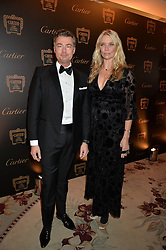 LAURENT FENIOU and JODIE KIDD at the 26th Cartier Racing Awards held at The Dorchester, Park Lane, London on 8th November 2016.