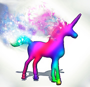 Colourful Unicorn in 3D with a colorful wake from it's tail and mane