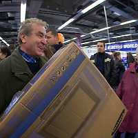 Customers fight each other for the cheap LCD televisions on sale during the grand opening of the Electro World store in Arena Plaza.