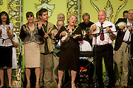 The Lady Mayor of Blackpool joining members of the George Formby Appreciation Society on stage as they play to the annual gathering in Blackpool playing his ukulele to the audience at the town's Winter Gardens. The society was formed in 1961 and holds an annual event to celebrate the life of the famous Lancastrian singer and entertainer.