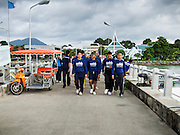 30 JULY 2013 - KOH SAMET, RAYONG, THAILAND:  Thai Royal Navy volunteers march out to the boat that will take them to Koh Samet to clean up an oil spill. About 50,000 liters of crude oil poured out of a pipeline in the Gulf of Thailand over the weekend authorities said. The oil made landfall on the white sand beaches of Ao Prao, on Koh Samet, a popular tourists destination in Rayong province about 2.5 hours southeast of Bangkok. Workers from PTT Global, owner of the pipeline, and up to 500 Thai military personnel are cleaning up the beaches. Tourists staying near the spill, which fouled Ao Prao beach, were evacuated to hotels on the east side of the island, which was not impacted by the spill. PTT Global Chemical Pcl is part of state-controlled PTT Pcl, Thailand's biggest energy firm.     PHOTO BY JACK KURTZ