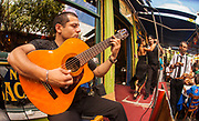 Guitar player and tango dancers at streetside cafe, La Boca, Buenos Aires, Argentina.