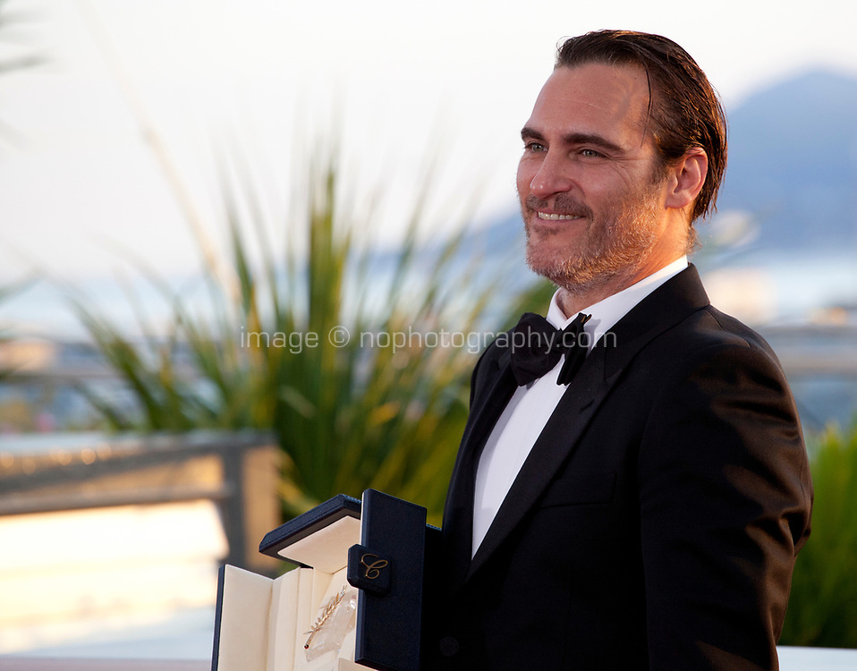 Actor Joaquin Phoenix with the award for Best Actor, for his part in the film You Were Never Really Here, at the Award Winner's Photocall at the 70th Cannes Film Festival Saturday 27th May 2017, Cannes, France. Photo credit: Doreen Kennedy