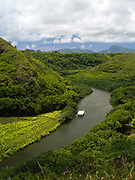View of Wailua River and people kayaking, near Lihue, Kauai, Hawaii, US.