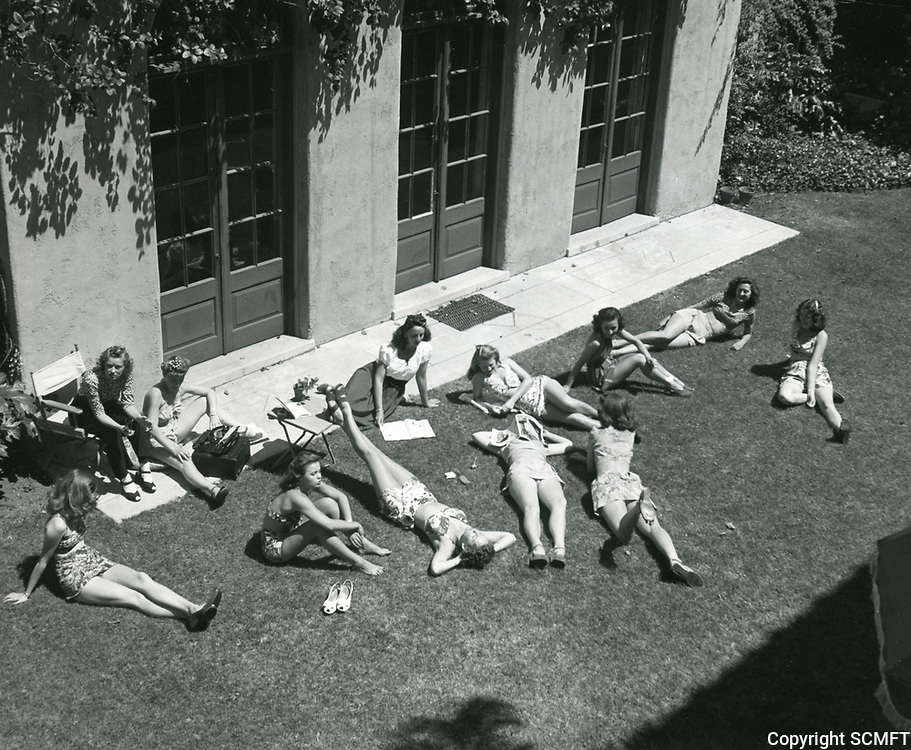 1950 Ladies sunbathing at the Hollywood Studio Club at 1215 Lodi Place