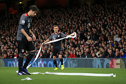 7 March 2017 - UEFA Champions League - (Round of 16) - Arsenal v Bayern Munich - Rafinha (R) and Javi Martinez of Bayern Munich help to clear the pitch of paper thrown by the Bayern fans - Photo: Marc Atkins / Offside.