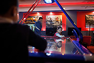 Twins Emre (left) and Esra (right) play air hockey in one of the arcades in the Kayseri Forum shopping centre in the central Turkish city.