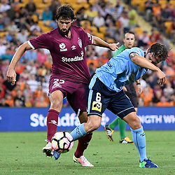 BRISBANE, AUSTRALIA - NOVEMBER 19: Joshua Brillante of Sydney and Thomas Broich of the Roar compete for the ball during the round 7 Hyundai A-League match between the Brisbane Roar and Sydney FC at Suncorp Stadium on November 19, 2016 in Brisbane, Australia. (Photo by Patrick Kearney/Brisbane Roar)