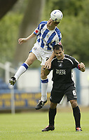Fotball<br /> England 2005/2006<br /> Foto: SBI/Digitalsport<br /> NORWAY ONLY<br /> <br /> Huddersfield v Swansea<br /> Coca Cola League 1.<br /> 13/08/2005.<br /> Huddersfield's Andy Booth beats Swansea's Roberto Martinez to the ball