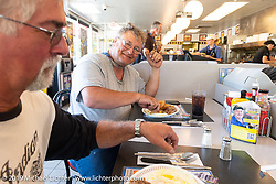 Tim McIntyre on lunch-break at a Waffle House during the Cross Country Chase motorcycle endurance run from Sault Sainte Marie, MI to Key West, FL. (for vintage bikes from 1930-1948). Stage-6 from Chattanooga, TN to Macon, GA USA covered 258 miles. Wednesday, September 11, 2019. Photography ©2019 Michael Lichter.