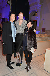 Left to right, NAT WELLER, OLIVIA INGE and BEATRIX ONG at a private view of Alexander McQueen's Savage Beauty exhibition hosted by Samsung BlueHouse at the V&A, London on 30th March 2015.