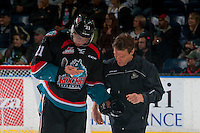 KELOWNA, CANADA - OCTOBER 26: Kelowna Rockets' athletic therapist, Scott Hoyer, checks on Devante Stephens #21 of the Kelowna Rockets after an injury against the Victoria Royals on October 26, 2016 at Prospera Place in Kelowna, British Columbia, Canada.  (Photo by Marissa Baecker/Shoot the Breeze)  *** Local Caption ***