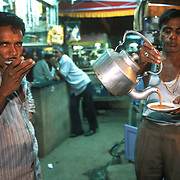 There is nothing fancy about drinking tea in India. Tea drinking, for the average Indian familiar with the chai phenomenon, is usually done in a matter of minutes. A few whiffs, a couple of slurps and the sticky-sweet, over-boiled milky drink is gulped down on the go at a roadside chaiwallah..In Gujarat it is sipped from plates and not cups so it is even easier to cool down. Talala, November 2003