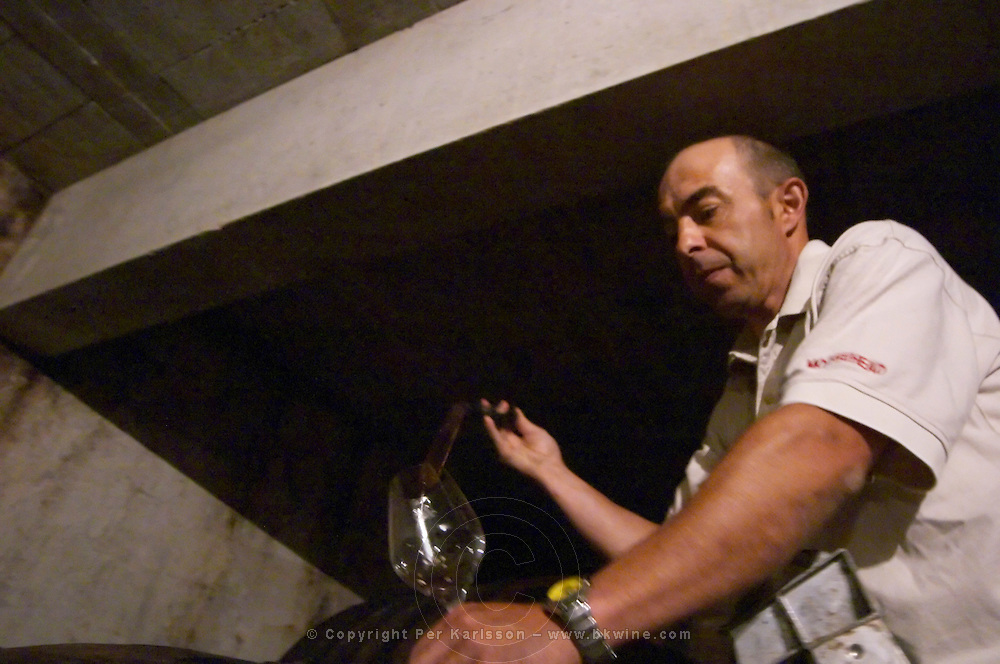 Sylvain Fadat Domaine d'Aupilhac. Montpeyroux. Languedoc. Pouring a wine sample in a glass. Owner winemaker. France. Europe.
