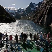 Three weeks aboard the Kong Harald. Hurtigruten, the Coastal Express. Navigation inside the Trollfjord. Lofotens.