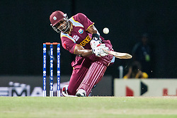 © Licensed to London News Pictures. 05/10/2012. West Indian Kieron Pollard plays a shot over his head during the World T20 Cricket Mens Semi Final match between Australia Vs West Indies at the R Premadasa International Cricket Stadium, Colombo. Photo credit : Asanka Brendon Ratnayake/LNP
