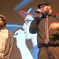 Phillip Torres, aka Flux 451, and Dominic Ruiz, aka Dahhm Life, perform a Zoology song while photos of their late group member Andrew Martinez, aka Wake Self, are projected in the background at El Morro Theatre in Gallup Saturday.