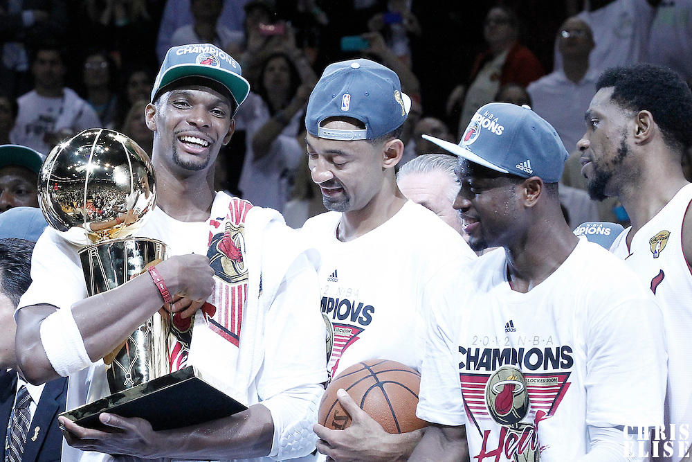 21 June 2012: Miami Heat power forward Chris Bosh (1) celebrates next to  Miami Heat power forward Juwan Howard (5) and Miami Heat shooting guard Dwyane Wade (3) after the Miami Heat 121-106 victory over the Oklahoma City Thunder, in Game 5 of the 2012 NBA Finals, at the AmericanAirlinesArena, Miami, Florida, USA. The Miami Heat wins the series 4-1.