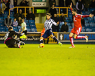 Lee Gregory of Millwall attempts a shot past Liam Grimshaw of Chesterfield during the Sky Bet League 1 match at The Den, London<br /> Picture by Richard Brooks/Focus Images Ltd 07947656233<br /> 21/02/2017