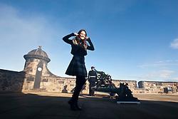 Miss Scotland Jennifer Reochs at the firing of the One O'clock gun by Gunner Jamie Shannon..The Miss World participants visit Edinburgh Castle and will witness the firing of the One O'clock gun..MISS WORLD 2011 VISITS SCOTLAND..Pic © Michael Schofield.