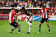 Lloyd James (4) of Exeter City battles for possession with Matthew Green (10) of Lincoln City with Craig Woodman (3) of Exeter City watching during the EFL Sky Bet League 2 match between Exeter City and Lincoln City at St James' Park, Exeter, England on 19 August 2017. Photo by Graham Hunt.
