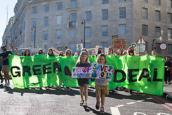 Hundreds of young people march during a Global Climate Strike to demand intersectional climate justice on 24th September 2021 in London, United Kingdom. The Global Climate Strike was organised to highlight the detrimental influences through colonialism, imperialism and exploitation of the Global North on MAPA (Most Affected Peoples and Areas), which have contributed to them now experiencing the worst impacts of the climate crisis, and to call on the Global North to pay reparations to MAPA.