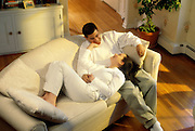 NJ, Morris County, Northeast, Hispanic couple on couch at home