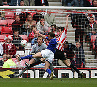 Photo. Andrew Unwin.<br /> Sunderland v Leicester City, Coca-Cola Championship, Stadium of Light, Sunderland 23/04/2005.<br /> Leicester's David Connolly (C) is put under pressure by Sunderland's Gary Breem (R) as he tries to take a shot on goal.